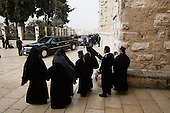 Clergy watch as the President's motorcade prepares to depart the Church of the Nativity in Bethlehem, the West Bank, March 22, 2013. .Mandatory Credit: Chuck Kennedy - White House via CNP