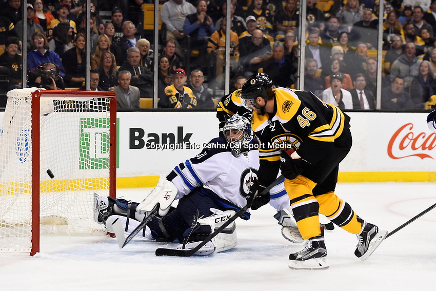 Thursday, October 8, 2015: Boston Bruins center David Krejci (46) scores a goal against Winnipeg Jets goalie Ondrej Pavelec (31) in the first period at the NHL game between the Winnipeg Jets and the Boston Bruins held at TD Garden, in Boston, Massachusetts. Eric Canha/CSM