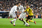 Real Madrid's Raphael Varane and Carlos Henrique Casemiro and Borussia Dortmund Emre Mor during the UEFA Champions League match between Real Madrid and Borussia Dortmund at Santiago Bernabeu Stadium in Madrid, Spain. December 07, 2016. (ALTERPHOTOS/BorjaB.Hojas)