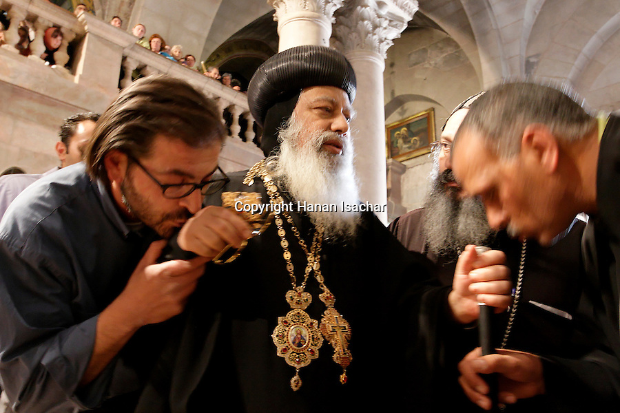 Israel, Jerusalem Old City, a Coptic Orthodox Priest entering the Church of the Holy Sepulchre on Holy Saturday. Easter 2005<br />