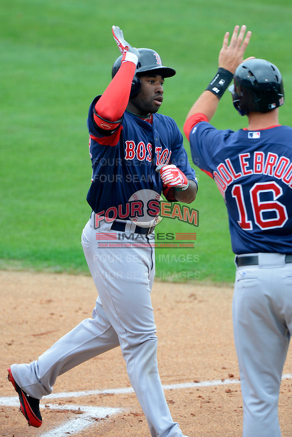 Boston Red Sox outfielder Jackie Bradley Jr. #74 is greeted at home by Will Middlebrooks #16 after hitting a home run during a Spring Training game against the Philadelphia Phillies at Bright House Field on March 24, 2013 in Clearwater, Florida.  Boston defeated Philadelphia 7-6.  (Mike Janes/Four Seam Images)