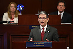U.S. Rep. Joe Heck, R-Nevada, speaks to a joint session of the Legislature in Carson City, Nev., on Wednesday, April 3, 2013. Assembly Speaker Marilyn Kirkpatrick, D-North Las Vegas, and Lt. Gov. Brian Krolicki are at rear. (AP Photo/Cathleen Allison)