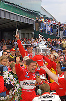 87th Indianapolis 500, Indianapolis Motor Speedway, Speedway, Indiana, USA  25 May,2003.As he climbs from his car, Gil de Ferran and Team Penske celebrate..World Copyright©F.Peirce Williams 2003 .ref: Digital Image Only..F. Peirce Williams .photography.P.O.Box 455 Eaton, OH 45320.p: 317.358.7326  e: fpwp@mac.com..