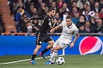 Lucas Vazquez of Real Madrid fights for the ball with Elseid Hysaj of SSC Napoli during the match Real Madrid vs Napoli, part of the 2016-17 UEFA Champions League Round of 16 at the Santiago Bernabeu Stadium on 15 February 2017 in Madrid, Spain. Photo by Diego Gonzalez Souto / Power Sport Images