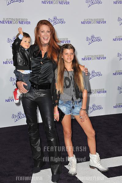 "Angie Everhart & children at the Los Angeles premiere of ""Justin Bieber: Never Say Never"" at the Nokia Theatre LA Live..February 8, 2011  Los Angeles, CA.Picture: Paul Smith / Featureflash"