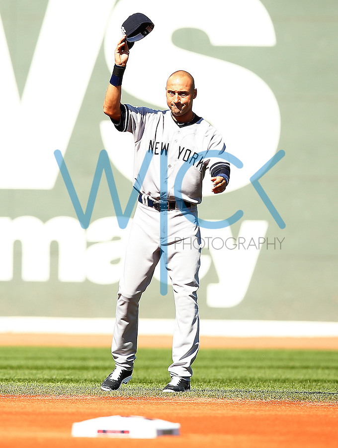 Derek Jeter #2 of the New York Yankees acknowledges the crowd during pregame ceremonies against the Boston Red Sox at Fenway Park in his final career game on September 27, 2014 in Boston, Massachusetts. (Photo by Jared Wickerham for the New York Daily News)