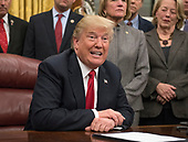 United States President Donald J. Trump makes remarks prior to signing the bipartisan Interdict Act, a bill to stop the flow of opioids into the United States in the Oval Office of the White House in Washington, DC on Wednesday, January 10, 2018.  The Interdict Act will provide Customs and Border Protection agents with the latest screening technology devices used to secure our border from illicit materials, specifically fentanyl, a powerful opioid that is destroying lives across the country. <br /> Credit: Ron Sachs / Pool via CNP