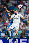 Karim Benzema (R) of Real Madrid competes for the ball with Leandro Cabrera Sasia of Getafe CF during the La Liga 2018-19 match between Real Madrid and Getafe CF at Estadio Santiago Bernabeu on August 19 2018 in Madrid, Spain. Photo by Diego Souto / Power Sport Images
