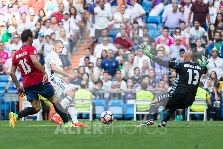 Real Madrid's Karim Benzema and Club Atletico Osasuna's Unai Garcia and NAuzet Perez  during the match of La Liga between Real Madrid and Club Atletico Osasuna at Santiago Bernabeu Estadium in Madrid. September 10, 2016. (ALTERPHOTOS/Rodrigo Jimenez)