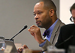Nevada Senate Minority Leader Aaron Ford, D-Las Vegas, works in committee at the Legislative Building in Carson City, Nev., on Wednesday, Feb. 11, 2015. Lawmakers are considering changes to the state's construction defect law. <br /> Photo by Cathleen Allison