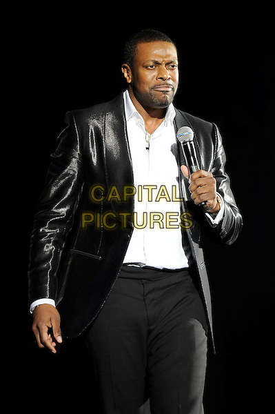 Chris Tucker.Performing his stand up show, Hammersmith Apollo, London, England, UK, 24th November 2012..show on stage comedy half length white shirt black jacket  leather shiny trousers microphone  .CAP/MAR.© Martin Harris/Capital Pictures.