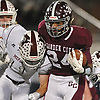 Trevor Yeboah-Kodie #24 of Garden City, right, fights for yards as Matt Hegi #11 of Mepham tries to stop him during the Nassau County Conference II varsity football final at Hofstra University on Friday, Nov. 17, 2017.