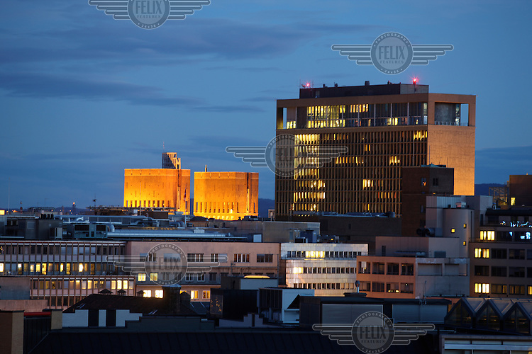 The Oslo city hall lit up (left centre).