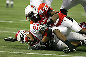 January 5th, 2008:  Rutgers running back Ray Rice (27) loses his helmet as he is tackled at the one yard line by Ball State defender Marcus McClure (23)during the second quarter of the International Bowl at the Rogers Centre in Toronto, Ontario Canada...Rutgers defeated Ball State 52-30.  ..Photo By:  Mike Janes Photography