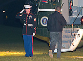 United States President Barack Obama salutes the Marine Guard as he boards Marine 1 to depart the White House in Washington, D.C. en route to Beijing, China on Sunday, November 9, 2014.<br /> Credit: Ron Sachs / Pool via CNP