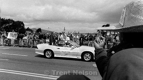 Man flips off officials at Gulf War celebration parade.<br />