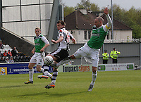 James McPake (right) challenges Paul McGowan in the St Mirren v Hibernian Clydesdale Bank Scottish Premier League match played at St Mirren Park, Paisley on 29.4.12.