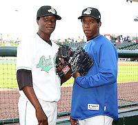 June 16th 2008:  Kennil Gomez and Neftali Feliz of the Clinton Lumberkings, Class-A affiliate of the Texas Rangers, during the Midwest League All-Star Home Run Derby at Dow Diamond in Midland, MI.  Photo by:  Mike Janes/Four Seam Images