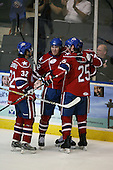 March 15, 2009:  Center David Brine (34) of the Rochester Amerks, AHL affiliate of Florida Panthers, celebrates a goal with Jordan Henry (25), Franklin MacDonald (32) and Randall Gelech (42) during the third period of a regular season game at the Blue Cross Arena in Rochester, NY.  Hamilton defeated Rochester 4-3 in a shoot out.  Photo Copyright Mike Janes Photography 2009