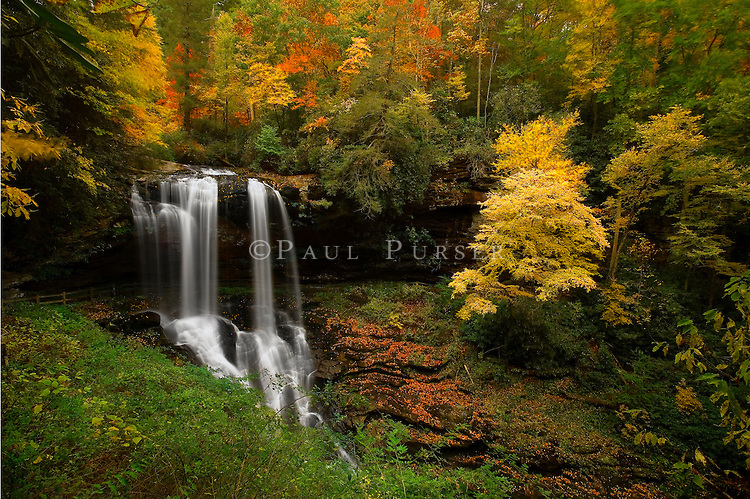 This is a photo of Dry Falls in the NC mountains, one of the best waterfalls that North Carolina has. This photo was taken in the fall when the color in the NC mountains was at peak. I have photographed this waterfall many times, and never felt  had a photo worth keeping, until I got this one. I consider this one of my better waterfall photos. There are over 500 waterfalls in this county, and you could spend weeks photographing, and not get them all.