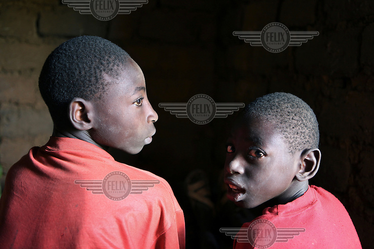 14 year old Jacques (left) has recently moved together with his family to a camp built by the UNHCR for returned refugees in the province of Ruyigi. His parents left Burundi during the war of 1972. They lived in a refugee camp in Tanzania where the father died of Aids. Jacques was born in Tanzania as a normal child, but when he was three years old he got a high fever, which led to the loss of the use of his legs. Recently the family was ordered to return to Burundi where they received a house. The mother complains that she is suffering from pain in her legs and she can't work. She doesn't know what she is suffering from but is unable to go to a health centre as she has no money for medical aid. During the first three months the family received a financial contribution for returned refugees but that money is now gone. A week ago Jacques received a tricycle from Handicap International. This will hopefully allow him to do some work, bring an income for the family and return to school.