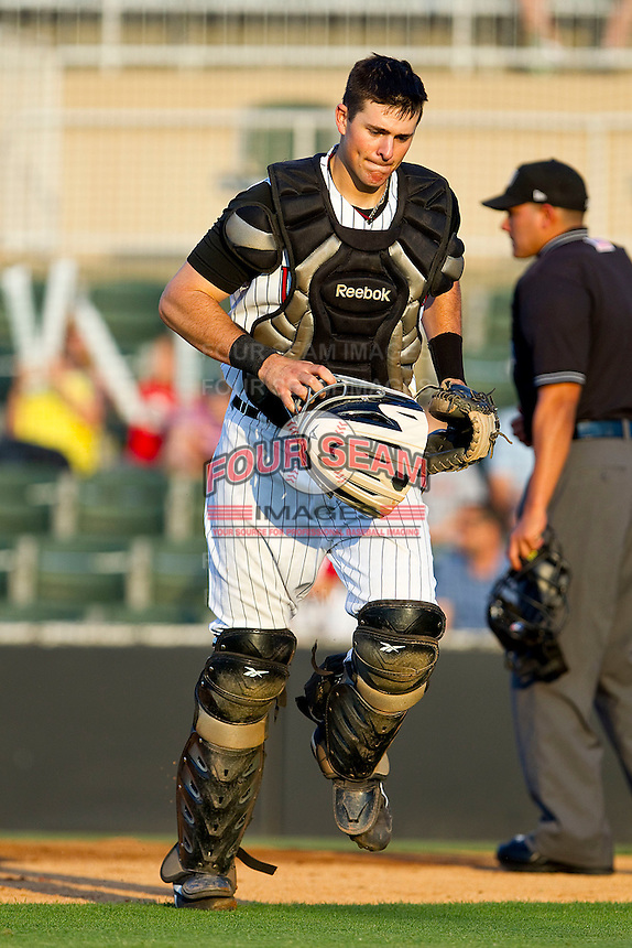 Mike Blanke #32 of the Kannapolis Intimidators jogs off the field at the end of an inning during the game against the Delmarva Shorebirds at Fieldcrest Cannon Stadium on May 20, 2011 in Kannapolis, North Carolina.   Photo by Brian Westerholt / Four Seam Images