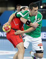 Algeria's Elkhoumini Hamoud (r) and Egypt's Omar Elsweidy during 23rd Men's Handball World Championship preliminary round match.January 15,2013. (ALTERPHOTOS/Acero) /NortePhoto