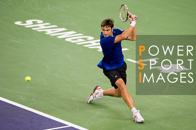 SHANGHAI, CHINA - OCTOBER 12:  Tommy Robredo of Spain returns a ball to Tomas Berdych of Czech Republic during day two of the 2010 Shanghai Rolex Masters at the Shanghai Qi Zhong Tennis Center on October 12, 2010 in Shanghai, China.  (Photo by Victor Fraile/The Power of Sport Images) *** Local Caption *** Tommy Robredo