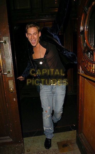 LEE RYAN.At Myla's Debutante's Lingerie Fashion Show,.Porchester Hall, London, England, .January 31st 2006..full length arms up funny gesture black sheer see through shirt nipples chest blue velvet jacket ripped jeans.Ref: CAN.www.capitalpictures.com.sales@capitalpictures.com.©Can Nguyen/Capital Pictures
