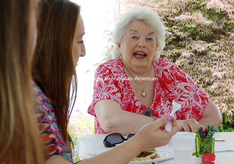 OXFORD CT. 26 July 2014-072614SV01-Mary Poeta of Beacon Falls, Nina&rsquo;s great aunt, enjoys a picnic in Nina Poeta&rsquo;s honor in Oxford Saturday. A picnic and silent auction was held at The Colonial Tavern to benefit Nina Poeta of Seymour who is battling cancer. <br /> Steven Valenti Republican-American
