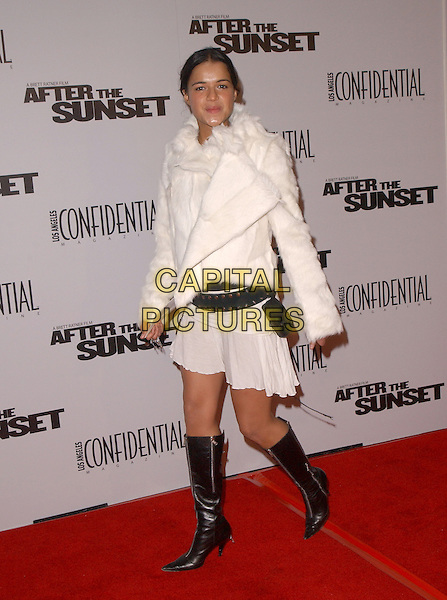 """MICHELLE RODRIGUEZ.The New Line Cinema's L.A. Premiere of """"After the Sunset"""" held at The Mann's Chinese Theatre in Hollywood, California .November 4, 2004.full length, black boots, white mini skirt, white fur coat, jacket, black studded belt.www.capitalpictures.com.sales@capitalpictures.com.© Capital Pictures."""