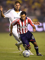 Chivas USA defender Jonathan Bornstein moves past LA Galaxy defender Omar Gonzalez. The LA Galaxy defeated Chivas USA 1-0 and win the playoff series during a MLS Western Conference playoff game at Home Depot Center stadium in Carson, California on Sunday November 1, 2009...