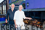 Chris Robbins and Ger Power preparing for the annual O Riada's  Kerry Hospic Pig Roast Fundraiser on Saturday