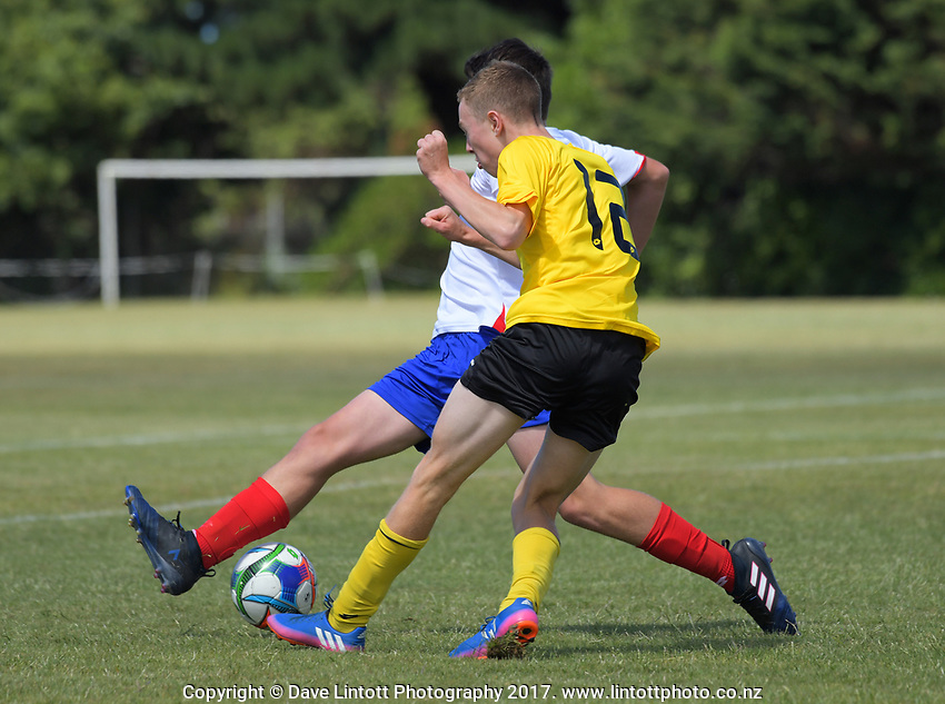 Action from the New Zealand Age Group Championships Under-14 Boys match between Auckland (white tops) and Capital at Memorial Park in Petone, Wellington, New Zealand on Thursday, 14 December 2017. Photo: Dave Lintott / lintottphoto.co.nz