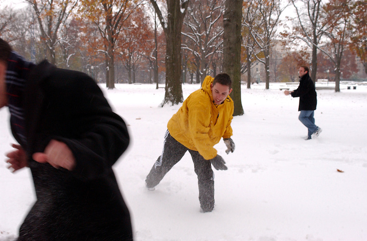 snow21_120502 -- Staffers from the Russell Senate Office Building enjoy a snow ball fight during the first snow storm of the winterin the upper senate park.