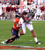 CHARLOTTESVILLE, VA- NOVEMBER 12: Wide receiver Marcus Davis #7 of the Virginia Tech Hokies is tackled by cornerback Drequan Hoskey #22 of the Virginia Cavaliers during the game on November 28, 2011 at Scott Stadium in Charlottesville, Virginia. Virginia Tech defeated Virginia 38-0. (Photo by Andrew Shurtleff/Getty Images) *** Local Caption *** Drequan Hoskey;Marcus Davis