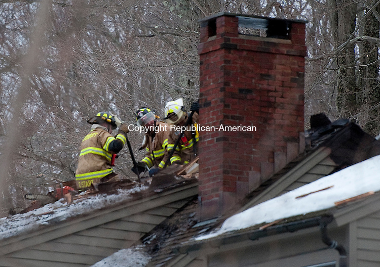 ROXBURY, CT-030714JS03--Firefighters from Roxbury and surrounding areas battled a house fire at a home at 264 Painter Hill Road in Roxbury on Friday. <br /> Jim Shannon Republican-American