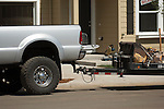 Ford Super Duty towing flatbed trailer on the construction jobsite