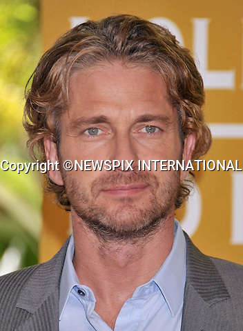 """GERARD BUTLER.attends The Hollywood Foreign Press Association's annual luncheon announcing its new officers and directors and presenting grants to non-profit entertainment related organizations and scholarship programs held at the Beverly Hills Hotel, Beverly Hills, Los Angeles_04/08/2011.Mandatory Photo Credit: ©Crosby/Newspix International. .**ALL FEES PAYABLE TO: """"NEWSPIX INTERNATIONAL""""**..PHOTO CREDIT MANDATORY!!: NEWSPIX INTERNATIONAL(Failure to credit will incur a surcharge of 100% of reproduction fees).IMMEDIATE CONFIRMATION OF USAGE REQUIRED:.Newspix International, 31 Chinnery Hill, Bishop's Stortford, ENGLAND CM23 3PS.Tel:+441279 324672  ; Fax: +441279656877.Mobile:  0777568 1153.e-mail: info@newspixinternational.co.uk"""