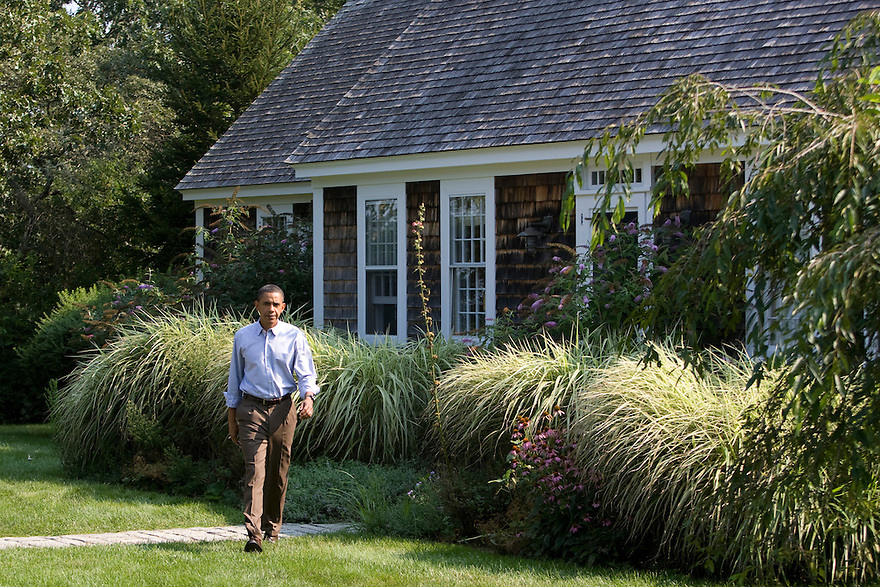 U.S. President Barack Obama walks from a building on his vacation compound to make a statement to the press in Chilmark on Martha's Vineyard.
