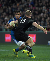 France's Wesley Fofana tries to step inside NZ's Jack Goodhue during the Steinlager Series international rugby match between the New Zealand All Blacks and France at Forsyth Barr Stadium in Wellington, New Zealand on Saturday, 23 June 2018. Photo: Dave Lintott / lintottphoto.co.nz