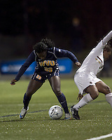 "West Virginia forward Bry McCarthy (33) successful tackle. Boston College defeated West Virginia, 4-0, in NCAA tournament ""Sweet 16"" match at Newton Soccer Field, Newton, MA."