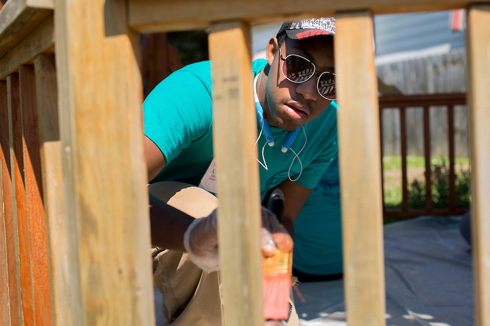 "Christian Sims applies wood stain to a gazebo during ""Circle the City with Service,"" the Kiwanis Circle K International's 2015 Large Scale Service Project, on Wednesday, June 24, 2015, in Indianapolis. (Photo by James Brosher)"