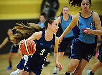 Action from the 2017 AA Girls' Secondary Schools Basketball Premiership National Championship match between Palmerston North Girls' High School (sky blue and navy) and Napier Girls' High School (navy and white) at the B&M Centre in Palmerston North, New Zealand on Monday, 2 October 2017. Photo: Dave Lintott / lintottphoto.co.nz