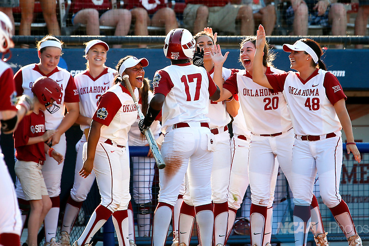 08 JUNE 2016:  The Oklahoma bench celebrates scoring a run during the Division I Women's Softball Championship is held at ASA Hall of Fame Stadium in Oklahoma City, OK.  Shane Bevel/NCAA Photos
