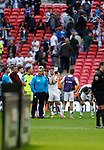 Tranmere Rovers 1 Forest Green Rovers 3, 14/05/2017. Wembley Stadium, Conference play off Final. Dejected Tranmere players and staff watch the Forest Green celebrations after the Vanarama Conference play off Final  between Tranmere Rovers v Forest Green Rovers at the Wembley. Photo by Paul Thompson.