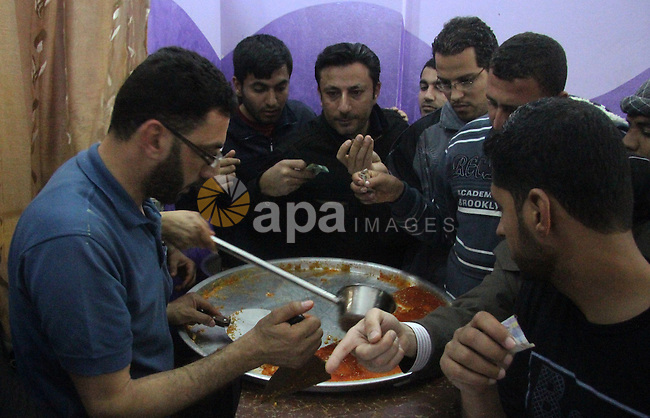 Palestinian former prisoners Hamouda Salah and Radwan Abu Turki, sell Kunafa at their sweet store in Gaza city on March 29, 2013. Salah and Abu Turki was released by Israel as part of the Gilad Shalit prisoner exchange agreement and banished from the West Bank city of Hebron to Gaza City. Photo by Ezz al-Zanoon