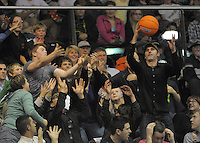 A fan in the crowd catches a promotional ball during the national basketball league match between Wellington Saints and Southland Sharks at TSB Bank Arena, Wellington, New Zealand on Friday, 5 July 2013. Photo: Dave Lintott / lintottphoto.co.nz