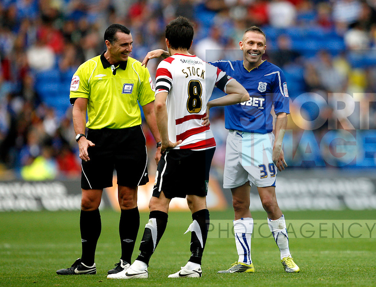 Craig Bellamy of Cardiff City shares a joke with the referee