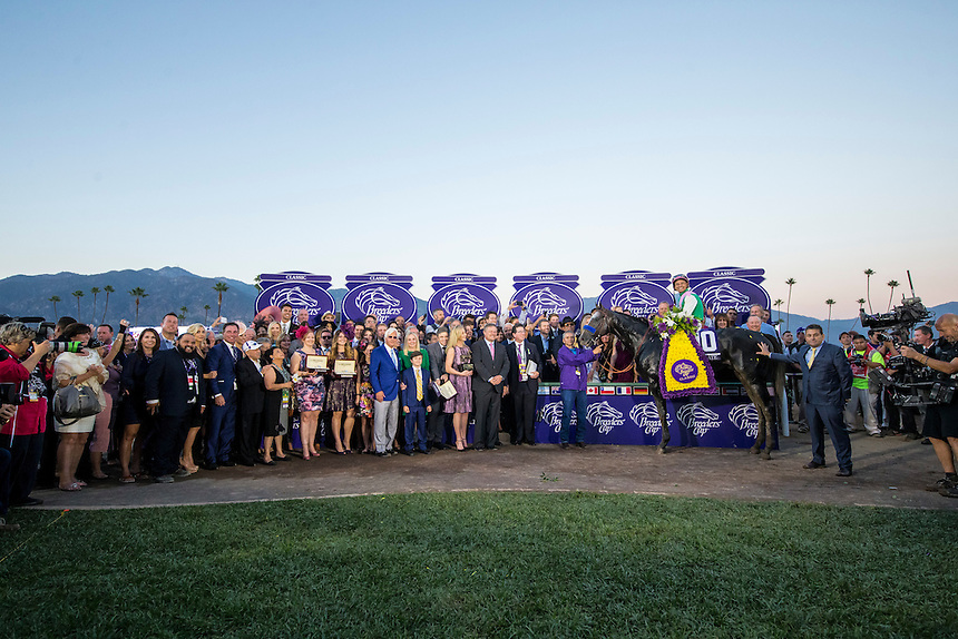 ARCADIA, CA - NOVEMBER 05: Mike Smith, aboard Arrogate #10, pose for a photograph with the connections  in the winner's circle after winning after winning the Breeders' Cup Classic during day two of the 2016 Breeders' Cup World Championships at Santa Anita Park on November 5, 2016 in Arcadia, California. (Photo by Alex Evers/Eclipse Sportswire/Breeders Cup)